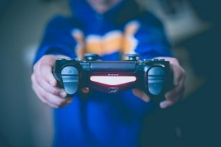 A boy wearing blue jacket bulk up during Netflix and game session